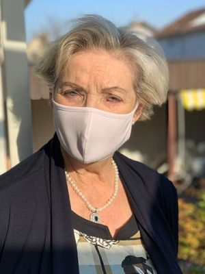 Elderly woman wearing mask
